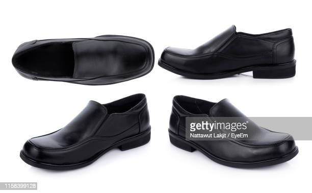 shoes against white background - black shoe stock pictures, royalty-free photos & images