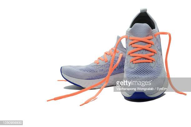 shoes against white background - sports shoe stock pictures, royalty-free photos & images