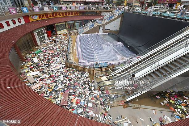 Shoes and bags float at a flooded shopping mall on July 10 2016 in Xinxiang China An overnight rainstorm hit Xinxiang in central China's Henan...