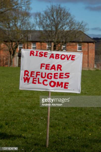 Shoes and banners placed outside Napier Barracks by local residents and community groups to mark the United Nations anti racism day in a COVID safe...