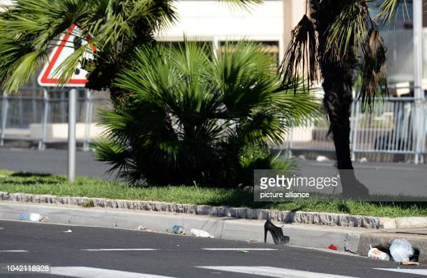 Shoes and debris lie at the scene in Nice France July 15 2016 where a truck drove into a crowd during Bastille Day celebrations At least 80 people...