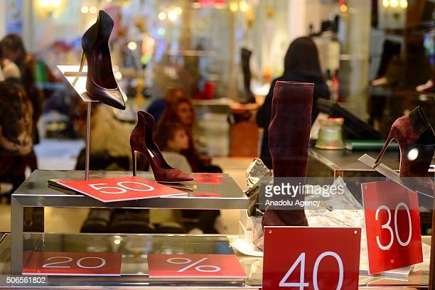 Shoes and discount rates are seen at a luxury shoe store in Moscow Russia on January 24 2016