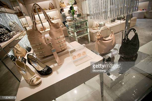 fd13c0cc4c46 ... Shoes and handbags are displayed in a Jimmy Choo Ltd retail store in  Hong Kong China