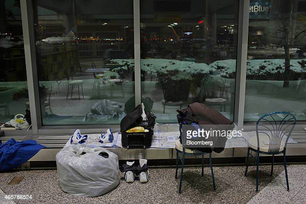 Shoes and luggage dry on a heater in Terminal B of LaGuardia Airport in New York on Saturday March 7 2015 While the homeless population is bigger at...