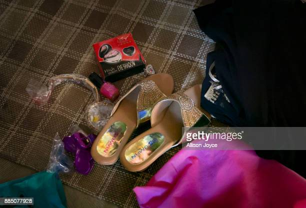 COX'S BAZAR BANGLADESH NOVEMBER 30 Shoes and makeup belonging to Nur Begum who doesn't know her age but thinks she is between 14 and 16 years old are...