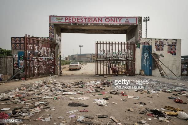 Shoes and remained items are seen at the main entrance of the Adokiye Amiesimaka Stadium where fifteen people were killed in a stampede the day...