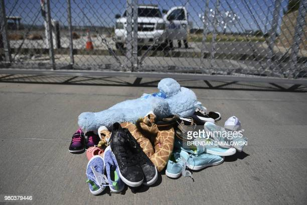 Shoes and toys for immigrant children are left at the Tornillo Port of Entry near El Paso Texas June 21 2018 during a protest rally by several...