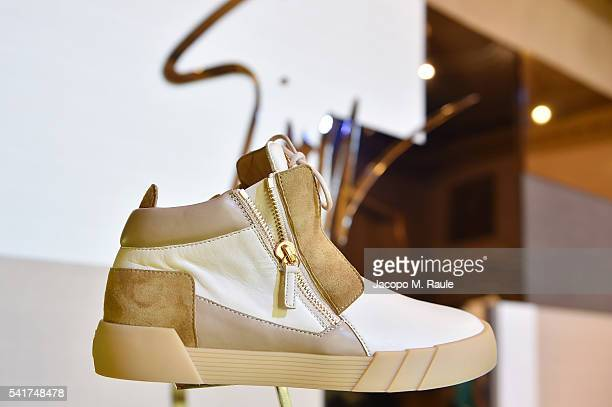 79fc9bbdae78b Shoes are displayed at Giuseppe Zanotti Design Presentation during Milan  Men's Fashion Week Spring/Summer