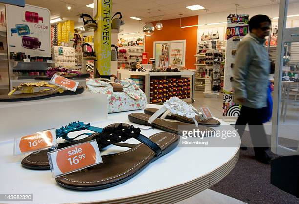 Shoes are displayed for sale at a Payless ShoeSource Inc. Store in New York, U.S., on Wednesday, May 2, 2012. JPMorgan Chase & Co. And Wells Fargo &...