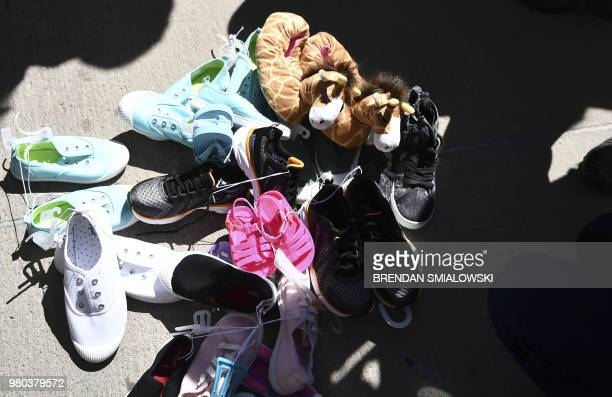 Shoes are left by people at the Tornillo Port of Entry near El Paso Texas June 21 2018 during a protest rally by several American mayors against the...