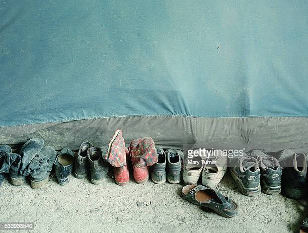 Shoes are lined up outside a tent where a family of ten have been living at the makeshift Idomeni refugee camp which has been home to an estimated...
