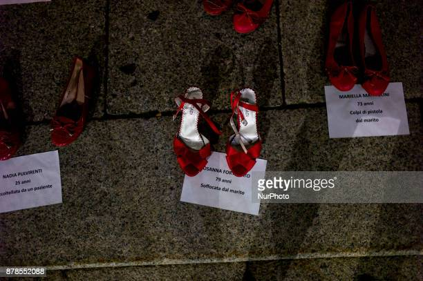 Shoes are painted in red to symbolize victims of violence in Crema, Italy, on November 24, 2017 as part of the International Day to End Violence...