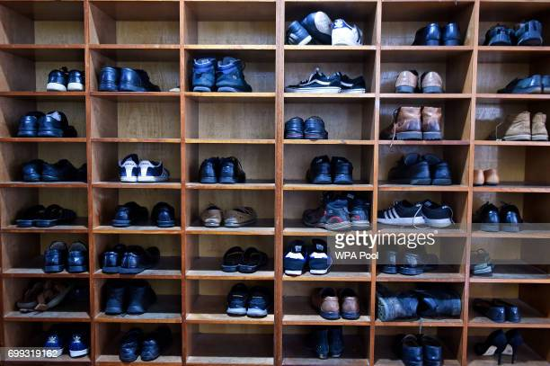 Shoes are pictured in a storage rack as Scotland's First Minister and Scottish National Party leader Nicola Sturgeon meets worshippers during a visit...