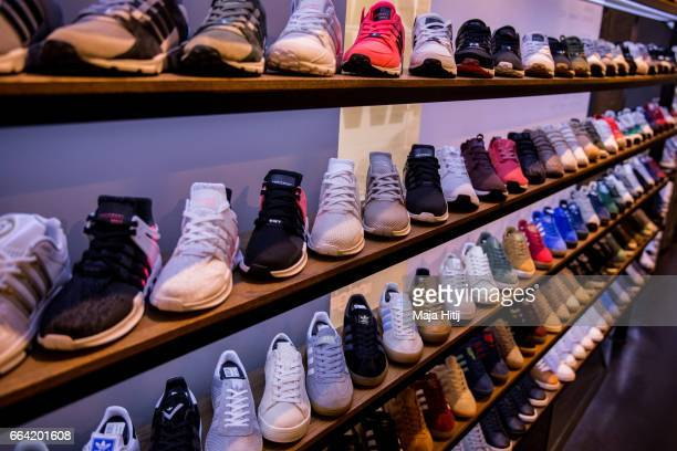 Shoes are seen at Overkill sneakers store on March 31 2017 in Berlin Germany during sale of New KAWS x Air Jordan IV sneakers Several dozen diehard...
