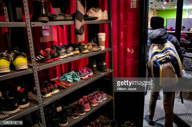 Shoes are seen on shelves at the Rohingya Cultural Center of Chicago on January 11 2019 in Chicago Illinois Chicago has one of the largest number of...