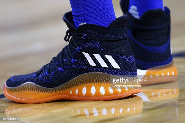 ADIDAS shoes are seen worn by Kristaps Porzingis of the New York Knicks during a game against the New Orleans Pelicans at the Smoothie King Center on...