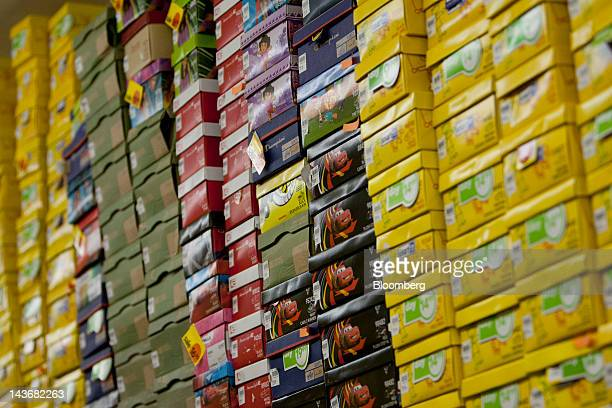 Shoes are stored in boxes at a Payless ShoeSource Inc. Store in New York, U.S., on Wednesday, May 2, 2012. JPMorgan Chase & Co. And Wells Fargo & Co....