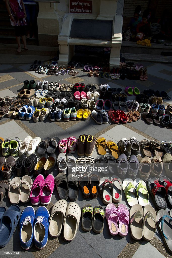 fc8a54209c89 Shoes arranged outside Buddhist temple   Stock Photo