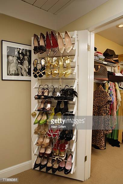 Shoes belonging to Janice Dickinson rest on a closet door during a portrait shoot at her home on April 27 2007 in the Hollywood Hills California...