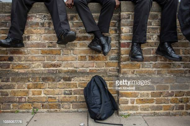 Shoes dangle as prison staff at HMP Wandsworth gather outside after staging a 'walkout' on September 14 2018 in London England The Prison Officers...