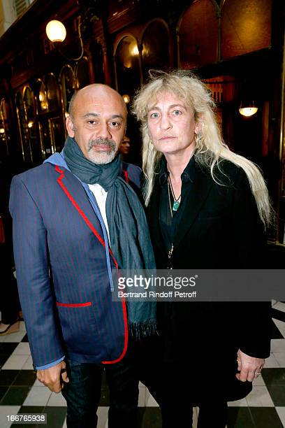 Shoes designer Christian Louboutin and Victoria Niarchos attend 'Renate Graf Carnet De Voyage' Photographies Exhibition opening party held at Galerie...