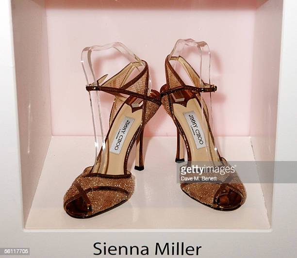 Shoes donated by Sienna Miller are displayed at the aftershow party following the UK premiere of In Her Shoes at the Grosvenor House Hotel on...
