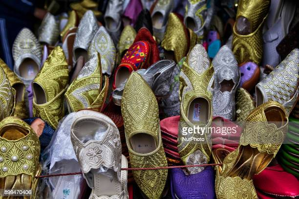 Shoes for sale in a souk in Tetouan Morocco Africa