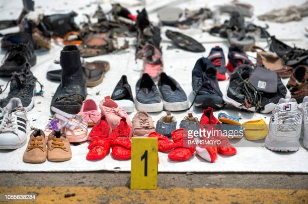 TOPSHOT Shoes found during the search for victims from the illfated Lion Air flight JT 610 are collected at the Jakarta International Container...