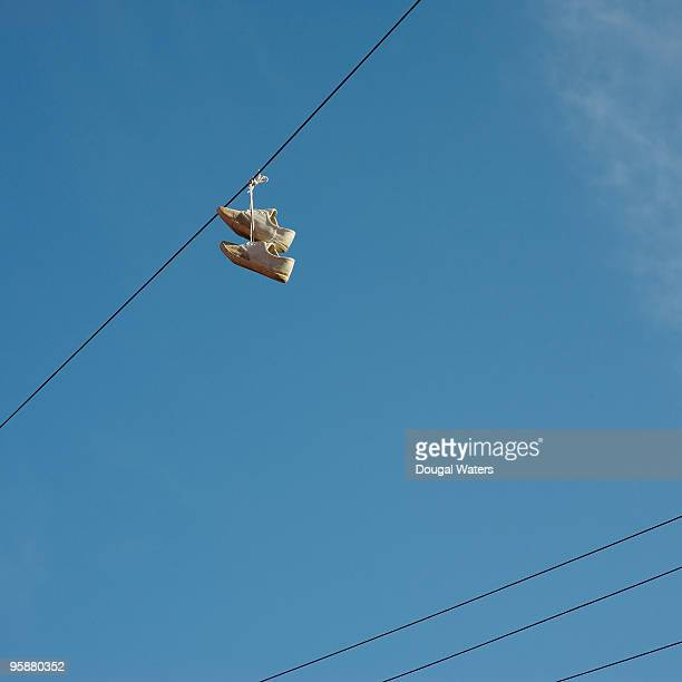 Shoes hanging from phone lines.