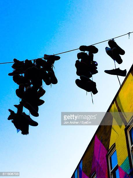 shoes hanging from power line - bethnal green stock pictures, royalty-free photos & images