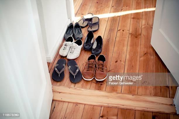 shoes in hallway - schuhwerk stock-fotos und bilder