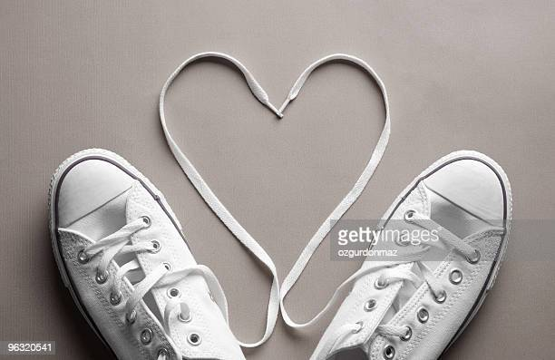 shoes in love - shoelace stock pictures, royalty-free photos & images