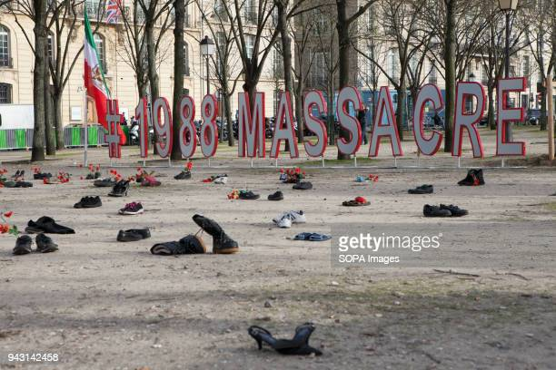 Shoes in the pictures are symbols of thousands of shoes left from 1988 Massacre in Iran Iranian demonstrate against violation of human rights and...