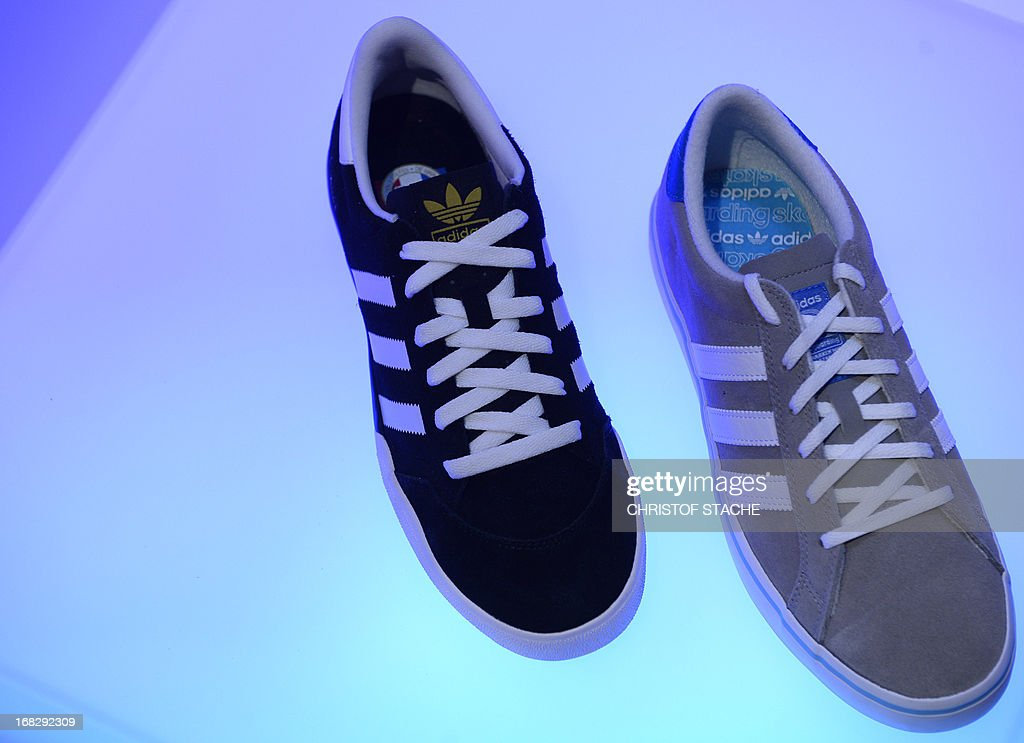Shoes of German sportswear company Adidas are on display on the