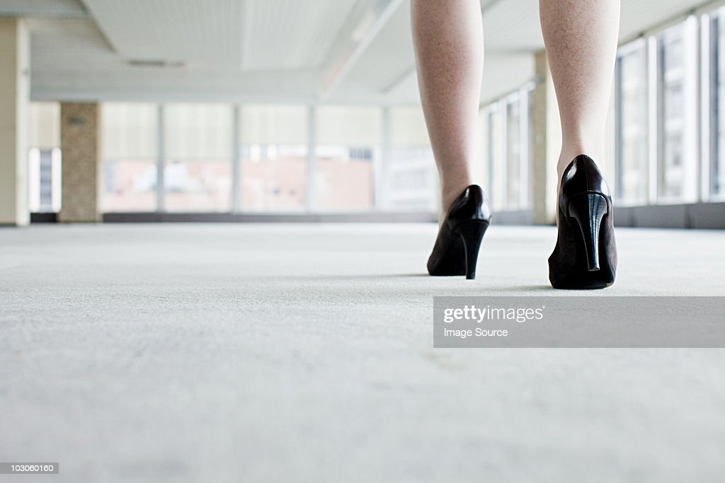 Shoes of woman walking in office : Stock Photo