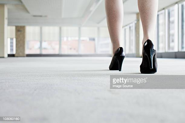 Shoes of woman walking in office