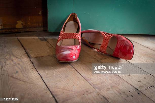 shoes on wooden floor - pair stock pictures, royalty-free photos & images