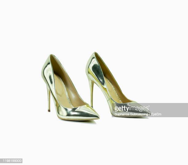 shoes over white background - gold shoe stock pictures, royalty-free photos & images