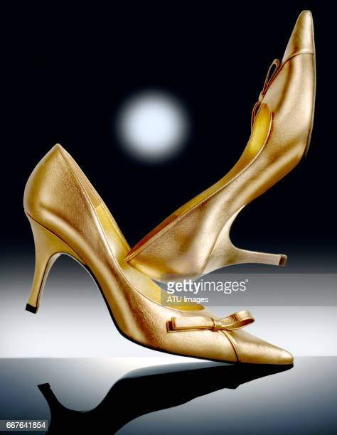 shoes - gold shoe stock pictures, royalty-free photos & images