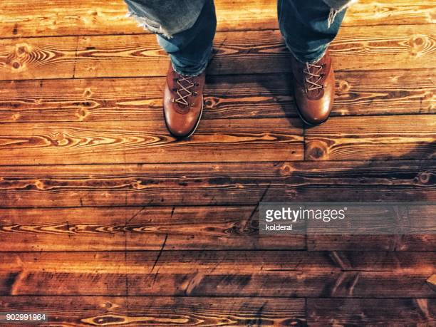 Shoes selfie- man wearing boots standing on hardwood floors