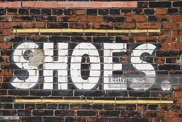Shoes Sign, Large Painted Letters on Old Brick Building