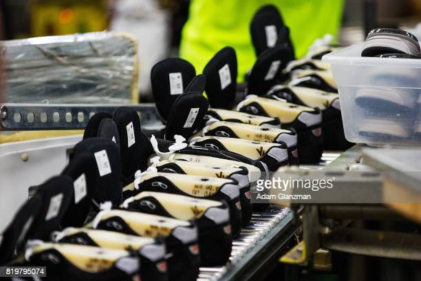 Shoes sit on a conveyor belt at the New Balance Shoe Factory before Speaker of the House Paul Ryan talks about tax reform during a visit to the...