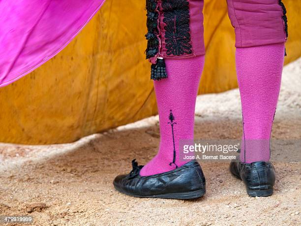 Shoes, socks and bullfighter's cape