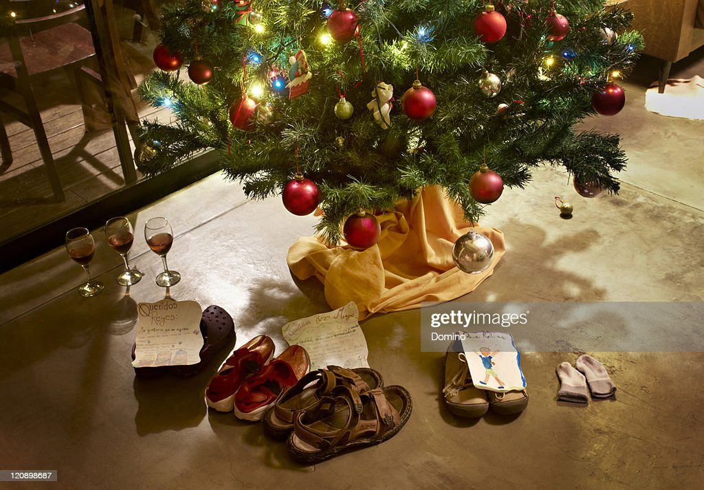 Shoes Under Christmas Tree Stock Photo