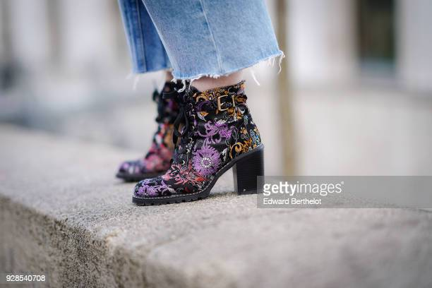 Shoes with embroidered flowers are seen outside Junko Shimada during Paris Fashion Week Womenswear Fall/Winter 2018/2019 on March 6 2018 in Paris...