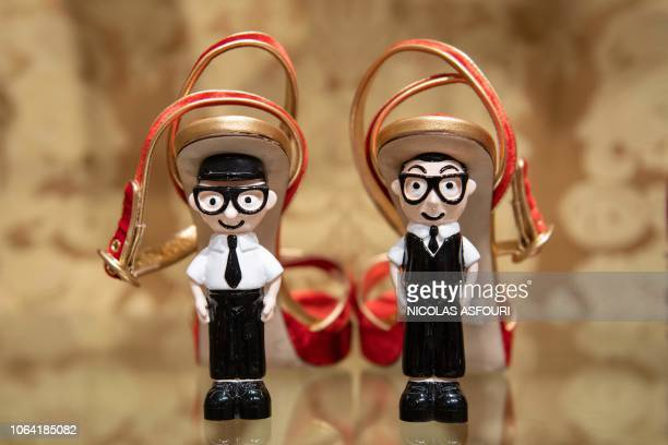 Shoes with the heels made out of figurines representing Italian fashion designers Domenico Dolce and Stefano Gabbana are displayed at a Dolce Gabbana...