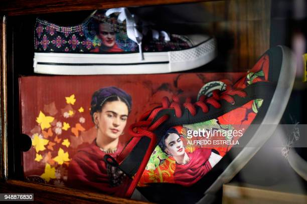 Shoes with the image of late Mexican artist Frida Kahlo are exhibited alongside other commercial products at her sister's house in the neighborhood...