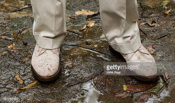 Shoes worn by Prince Charles Prince of Wales are splattered with rain during his visit to the elephant corridor at Vazhachal Forest Range on November...