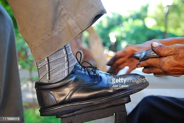 Shoeshiner at work - Granada, Nicaragua