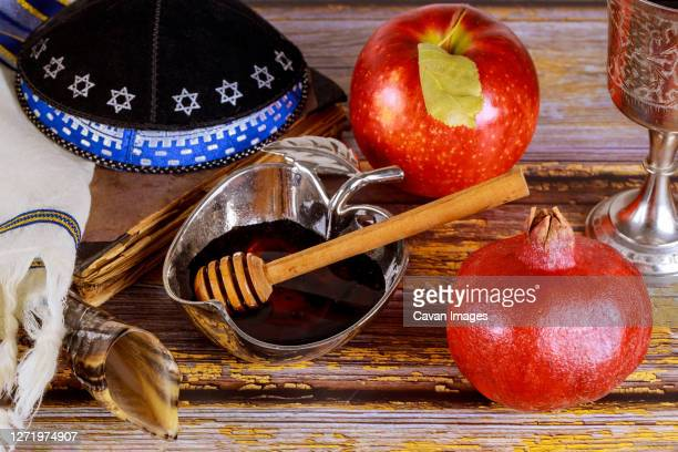 shofar and tallit with glass honey jar and fresh ripe apples. jewesh new year symbols. rosh hashanah - jewish prayer shawl stock pictures, royalty-free photos & images
